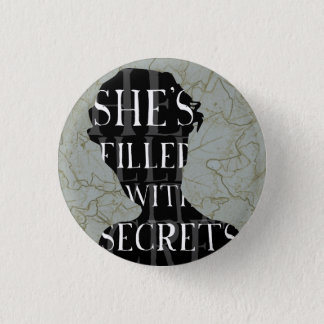 SHE'S FILLED WITH SECRETS 1 INCH ROUND BUTTON