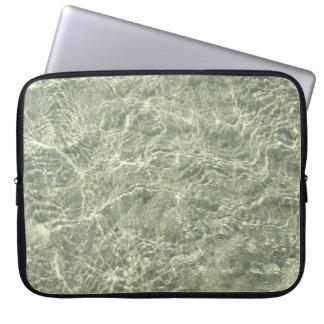 Shimmering sunlight through rippling water laptop sleeve