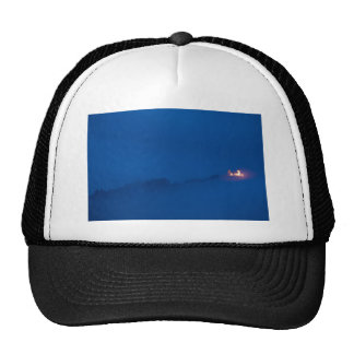 Shining through the storm clouds trucker hat