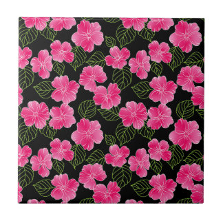 Shiny bright pink flowers,green leaves on black tile