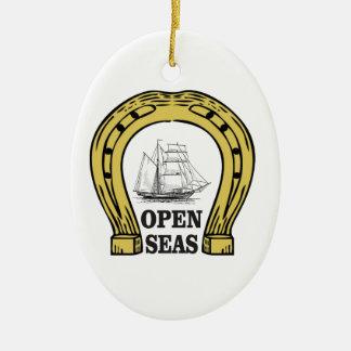 ship in open seas ceramic oval ornament