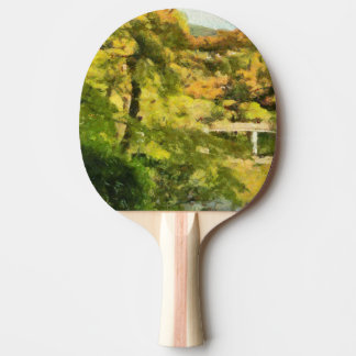 Shore of a small lake ping pong paddle
