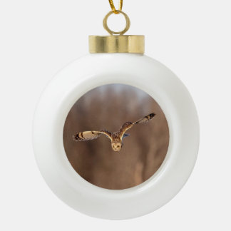 Short-eared owl diving towards the ground ceramic ball christmas ornament
