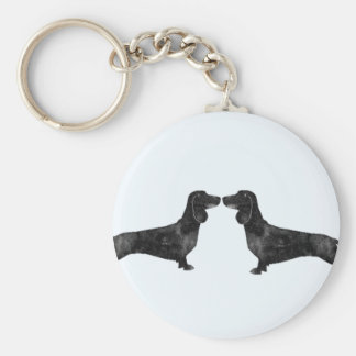 Short haired dachshund kissing key chain