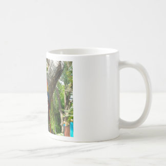 SHY PARROTS COFFEE MUG