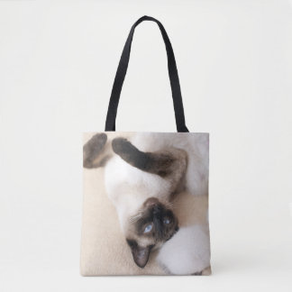 Siamese Cat lying on the back Photo Tote Bag