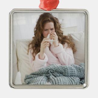 Sick woman on couch Silver-Colored square ornament