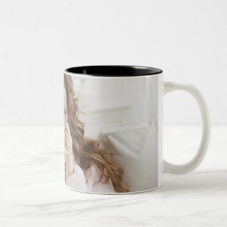 Sick woman on couch Two-Tone coffee mug