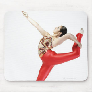 Side profile of a female gymnast practicing mouse pad