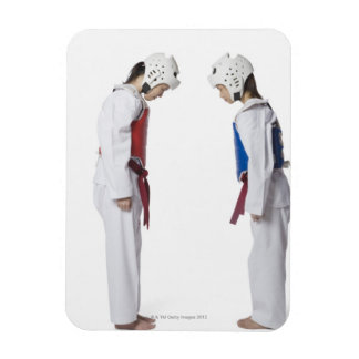 Side profile of two taekwondo players bowing rectangular photo magnet