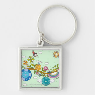 Side view of children playing on tree branch keychain