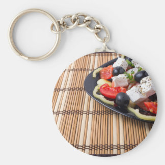 Side view of fresh vegetarian salad on plate basic round button keychain
