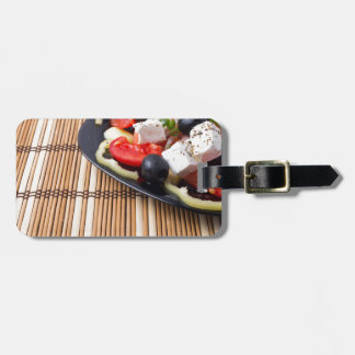 Side view of fresh vegetarian salad on plate luggage tag