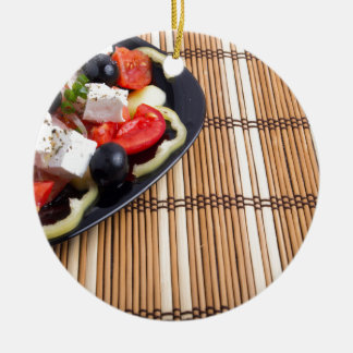 Side view of the Greek vegetarian salad of tomato Round Ceramic Ornament