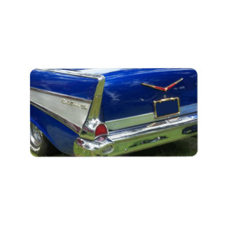 Side white tailfin on blue classic car