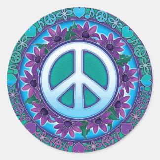 Signe de paix fleuri adhésif rond