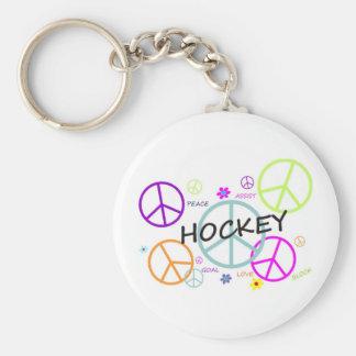 Signes de paix colorés par hockey porte-clé rond