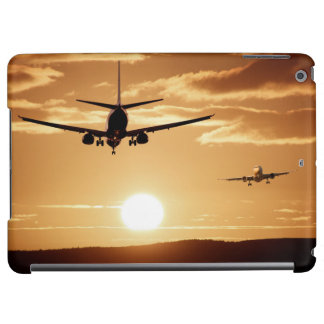 Silhouette jet airliners in the sunset sky iPad air case