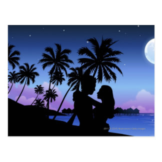Silhouette of a couple embracing on the beach postcard