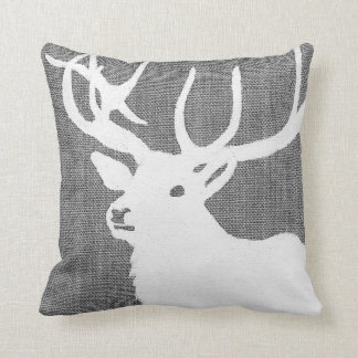 Silhouette of a white deer on a soft grey bckgrnd throw pillow