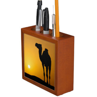 Silhouette of a wild camel at sunset desk organizer