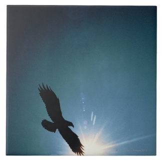 Silhouette of bald eagle flying in sky ceramic tile