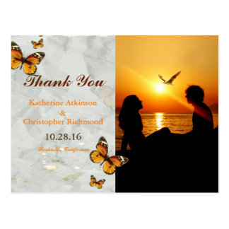 Silhouette of couple in sunset on the beach postcard