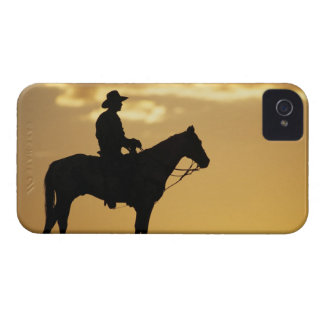 Silhouette of cowboy on horseback at sunset or iPhone 4 cases