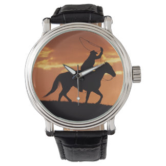 Silhouette of cowboy on horseback near Fairplay, Watches