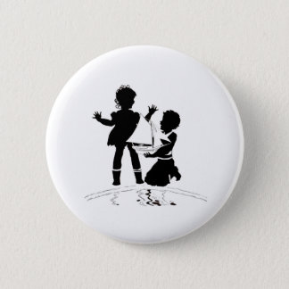 silhouette of girl and boy and model boat 2 inch round button