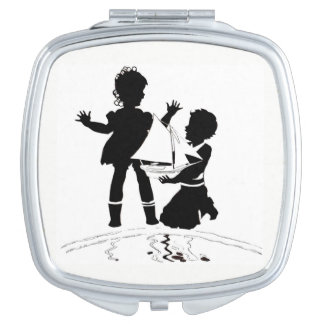 silhouette of girl and boy and model boat compact mirror