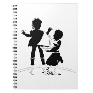 silhouette of girl and boy and model boat notebooks