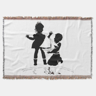 silhouette of girl and boy and model boat throw blanket
