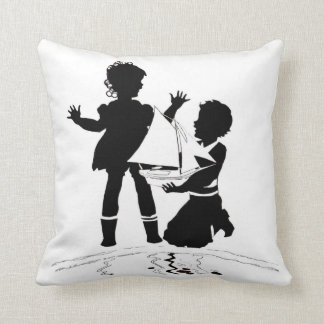 silhouette of girl and boy and model boat throw pillow
