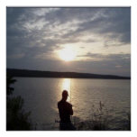 Silhouette of man fishing at sunset poster