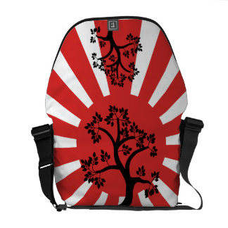 Silhouette tree on rising sun background messenger bag