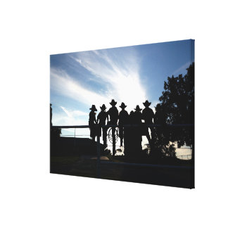 Silhouette western cowboys and cowgirls on fence canvas print