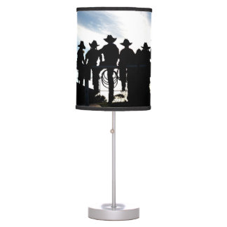 Silhouette western cowboys and cowgirls on fence desk lamp