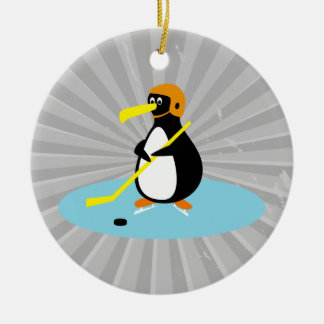 silly cute ice hockey penguin round ceramic ornament