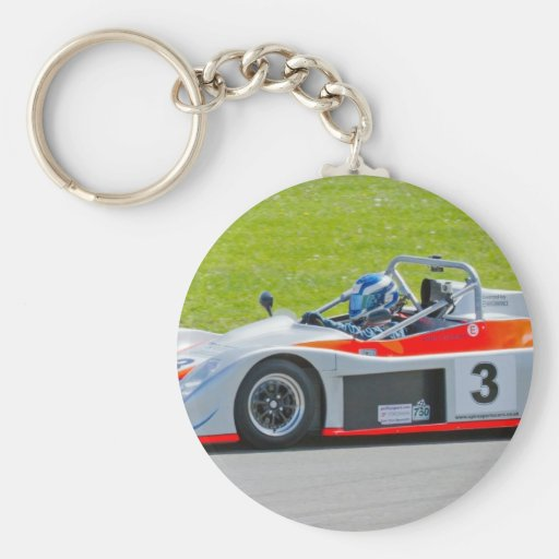 Silver and red single seater racing car key chain