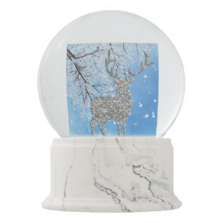 Silver glitter reindeer and snow snow globe