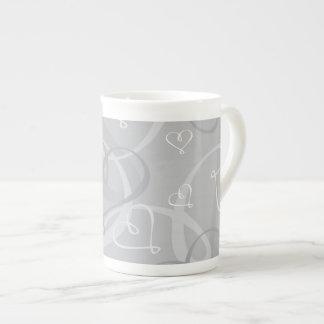 Silver heart pattern tea cup