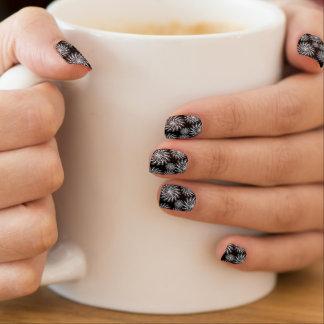 Silver spinning stars on black, nail art design