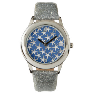 Silver stars on cobalt blue wrist watches