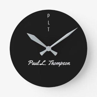 simple black wall clock with name