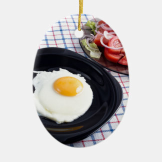 Simple homemade breakfast  from natural products ceramic oval ornament