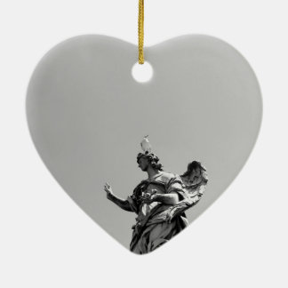 Simple, modern photo of seagull on top of statue ceramic heart ornament