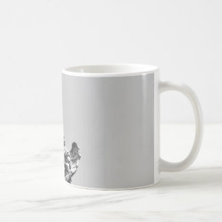 Simple, modern photo of seagull on top of statue coffee mug