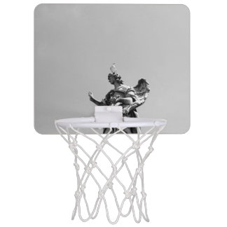 Simple, modern photo of seagull on top of statue mini basketball hoop