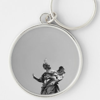 Simple, modern photo of seagull on top of statue Silver-Colored round keychain
